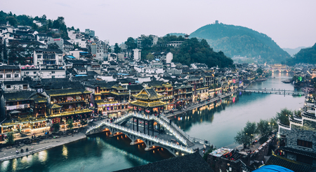 Hunan, China - Nov 6, 2015. Night view of Fenghuang Old Town in Hunan, China. The ancient town was added to the UNESCO World Heritage in 2008.