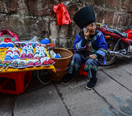 Hunan, China - Nov 6, 2015. Selling souvenirs at Fenghuang Old Town in Hunan, China. The ancient town was added to the UNESCO World Heritage in 2008. Redactioneel