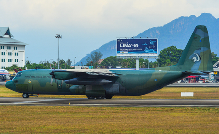 Langkawi, Malaysia - Mar 30, 2019. Lockheed C-130H Hercules Royal Malaysian Air Force (reg. TUDM M30-10) taxiing on runway of Langkawi Airport (LGK).