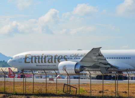 Phuket, Thailand - Apr 5, 2019. Emirates A6-EGR (Boeing 777-300ER) taxiing on runway of Phuket Airport (HKT).