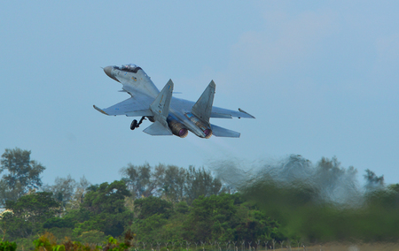 Langkawi, Malaysia - Mar 30, 2019. Royal Malaysian Air Force Sukhoi SU-30 MKM commencing take-off run at Langkawi Airport (LGK).