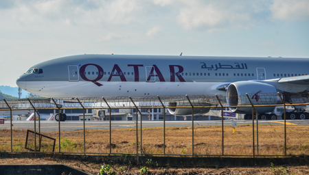Phuket, Thailand - Apr 5, 2019. Qatar Airways A7-BAZ (Boeing 777-300ER) taxiing on runway of Phuket Airport (HKT).