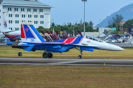 Langkawi, Malaysia - Mar 30, 2019. Su-30SM fighter jet belonging to the Russian Knights aerobatic demonstration team taxiing on runway of Langkawi Airport (LGK). Redactioneel