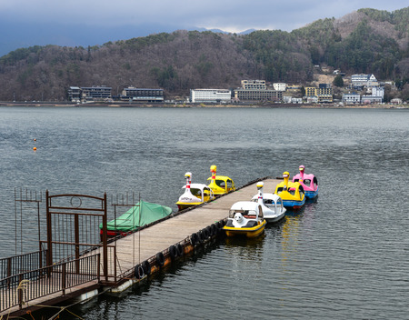 Kawaguchiko, Japan - Apr 8, 2019. Pedal swan boats on the Kawaguchiko Lake, Japan. Kawaguchiko is a mountain lake near famous Mount Fuji.