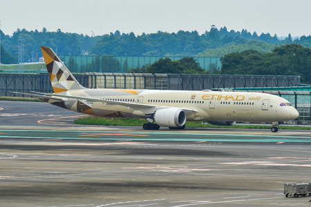 Tokyo, Japan - Jul 3, 2019. A6-BLQ Etihad Airways Boeing 787-9 Dreamliner taxiing on runway of Tokyo Narita Airport (NRT). Narita is one of the busiest airports in Asia.