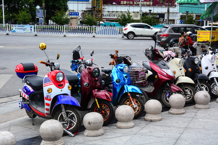 Nanning, China - Nov 1, 2015. Motorbikes parking on street in Nanning, China. Nanning is the capital and largest city by population of the Guangxi Zhuang. Editorial