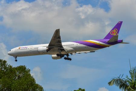 Singapore - Mar 27, 2019. Thai Airways HS-TKE (Boeing 777-300) landing at Changi Airport (SIN). Changi hits record 65 million passengers in 2018.