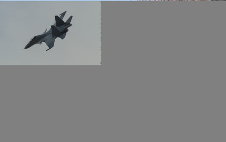 Fighter jet flying for display in Langkawi, Malaysia.