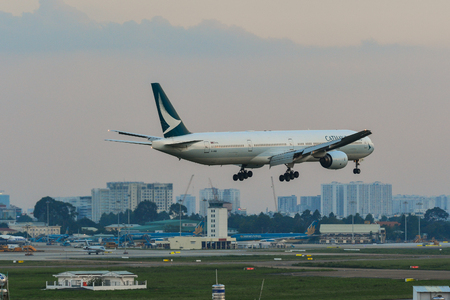 Saigon, Vietnam - Jul 10, 2019. B-HNQ Cathay Pacific Boeing 777-300 landing at Tan Son Nhat Airport (SGN). TSN is the busiest airport in Vietnam with 38 million passengers in 2018.