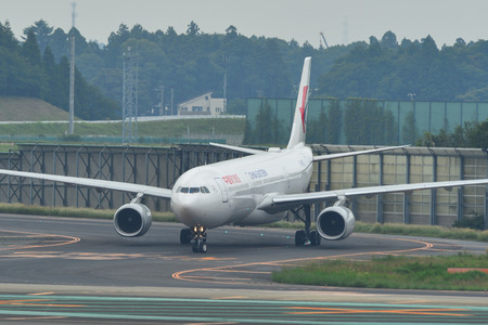 Tokyo, Japan - Jul 3, 2019. China Eastern Airlines B-8971 (Airbus A330-300) taxiing on runway of Tokyo Narita Airport (NRT). Narita is one of the busiest airports in Asia.