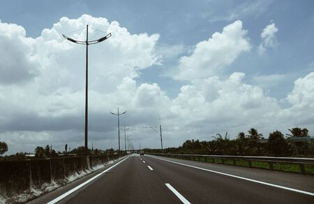 Highway at sunny day in Mekong Delta, Vietnam. Stock Photo