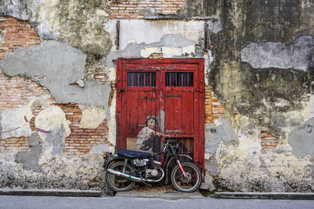 Georgetown, Malaysia - Aug 21, 2014. Penang Street Art, Georgetown Attractions. Beautiful wall painting of children all across historical Georgetown by Ernest Zacharevic.
