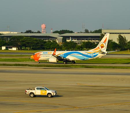 Bangkok, Thailand - Apr 24, 2018. HS-DBW Nok Air Boeing 737-800 taxiing on runway of Bangkok Don Muang International Airport (DMK). Editorial