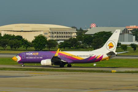 Bangkok, Thailand - Apr 24, 2018. HS-DBA Nok Air Boeing 737-800 taxiing on runway of Bangkok Don Muang International Airport (DMK).