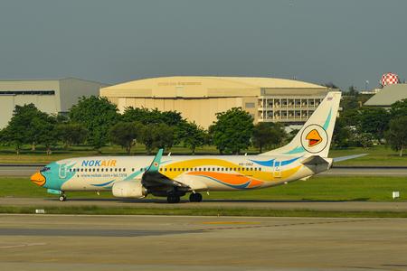 Bangkok, Thailand - Apr 24, 2018. HS-DBZ Nok Air Boeing 737-800 taxiing on runway of Bangkok Don Muang International Airport (DMK). Editorial