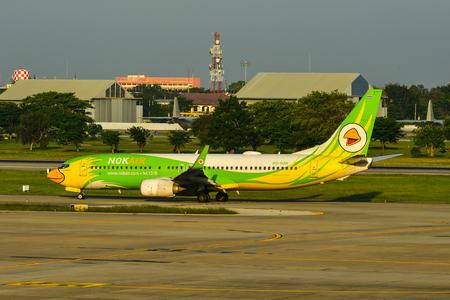 Bangkok, Thailand - Apr 24, 2018. HS-DBR Nok Air Boeing 737-800 taxiing on runway of Bangkok Don Muang International Airport (DMK).