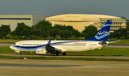 Bangkok, Thailand - Apr 24, 2018. NewGen Airways HS-NGG (Boeing 737-800) taxiing on runway of Bangkok Don Muang International Airport (DMK).