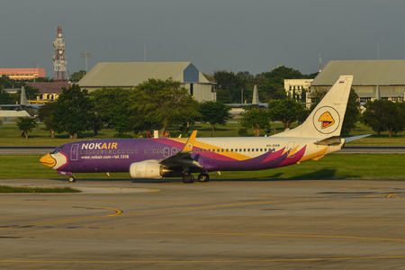 Bangkok, Thailand - Apr 24, 2018. HS-DBB Nok Air Boeing 737-800 taxiing on runway of Bangkok Don Muang International Airport (DMK). Editorial
