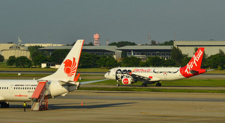 Bangkok, Thailand - Apr 24, 2018. Passenger airplanes taxiing on runway of Bangkok Don Muang International Airport (DMK).