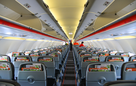 Tokyo, Japan - Jul 3, 2019.  Interior of Jetstar Airbus A320 docking at Tokyo Narita Airport (NRT). Narita is one of the busiest airports in Asia.
