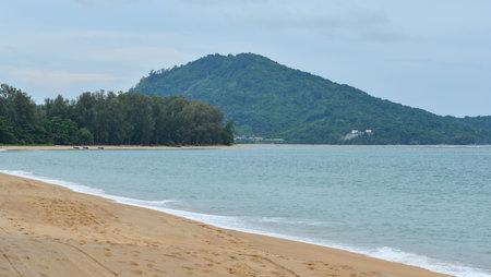 Naiyang beach at sunny day on Phuket Island, Thailand. Phuket is attracting millions of tourists every year.