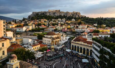 Athens, Greece - Oct 12, 2018. Night scene of Monastiraki Square and Ancient Acropolis Hill. Square is one of the principal shopping districts in Athens.