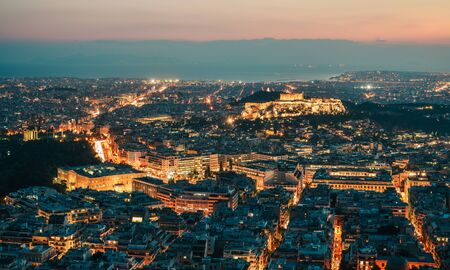 Night scene of Athens, Greece. Athens skyline at night viewed from Mount Lykavitos with Acropolis Hill. Banco de Imagens