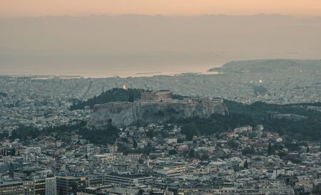 Beautiful sunset on the city of Athens, Greece. Athens is a tourist attraction that loves history and archeology. Banco de Imagens