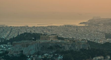 Beautiful sunset on the city of Athens, Greece. Athens is a tourist attraction that loves history and archeology. Фото со стока
