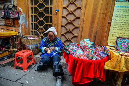 Hunan, China - Nov 6, 2015. Selling souvenirs at Fenghuang Old Town in Hunan, China. The ancient town was added to the UNESCO World Heritage in 2008. Editorial