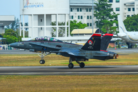 Langkawi, Malaysia - Mar 30, 2019. McDonnell Douglas FA-18D Hornet of Royal Malaysian Air Force (TUDM M45-01) taking-off from Langkawi Airport (LGK). Stockfoto - 129475943