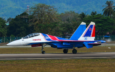 Langkawi, Malaysia - Mar 30, 2019. Su-30SM fighter jet belonging to the Russian Knights aerobatic demonstration team taxiing on runway of Langkawi Airport (LGK). Redactioneel