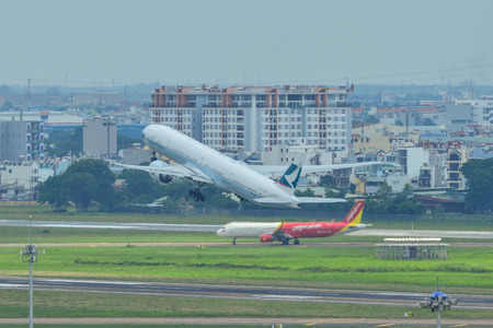 Saigon, Vietnam - Jul 13, 2019. B-KPI Cathay Pacific Boeing 777-300ER taking-off from Tan Son Nhat Airport (SGN).