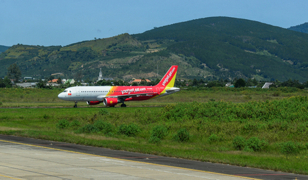 Dalat, Vietnam - Oct 30, 2015. An Airbus A320 airplane of Vietjet Air taxiing on runway of Lien Khuong Airport (DLI) in Dalat, Vietnam.