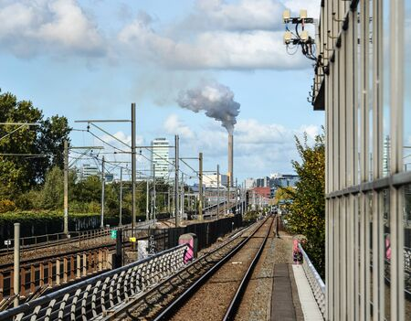 Amsterdam, Holland - Oct 7, 2018. Intercity train rail track in Amsterdam Central. Amsterdam is one of the greenest city in the world. Stock fotó
