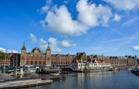 Amsterdam, Holland - Oct 7, 2018. Canals of the Amsterdam city. The historical canals of the city surrounded by traditional Dutch houses is main attractions of Amsterdam.