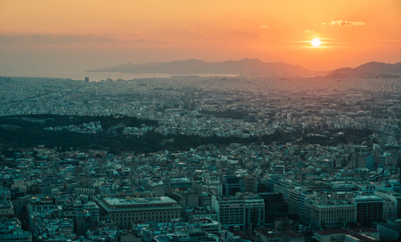 Beautiful sunset on the city of Athens, Greece. Athens is a tourist attraction that loves history and archeology. 에디토리얼