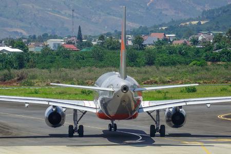 Dalat, Vietnam - Apr 20, 2018. VN-A560 Jetstar Pacific Airbus A320 airplane docking at Lien Khuong Airport (DLI) in Dalat, Vietnam. Sajtókép