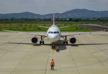 Dalat, Vietnam - Apr 20, 2018. HS-VKD Thai Vietjet Air Airbus A320 docking at Lien Khuong Airport (DLI) in Dalat, Vietnam.
