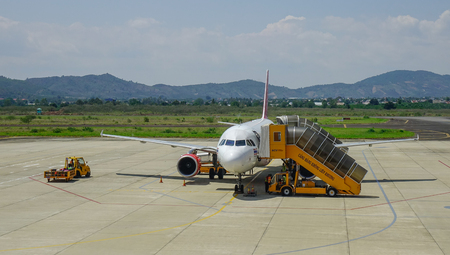 Dalat, Vietnam - Apr 20, 2018. HS-VKD Thai Vietjet Air Airbus A320 docking at Lien Khuong Airport (DLI) in Dalat, Vietnam. Sajtókép