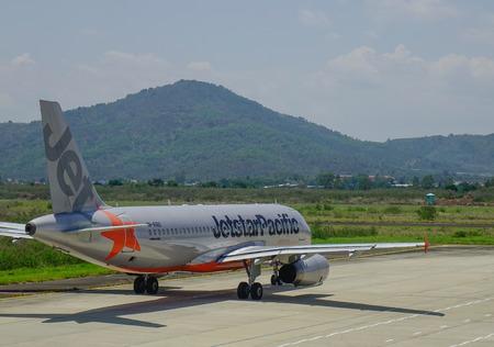 Dalat, Vietnam - Apr 20, 2018. VN-A560 Jetstar Pacific Airbus A320 airplane docking at Lien Khuong Airport (DLI) in Dalat, Vietnam.