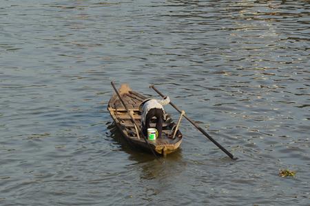 Soc Trang, Vietnam - Feb 2, 2016. A woman rowing boat on Mekong River in Nga Nam District, Soc Trang, Vietnam.