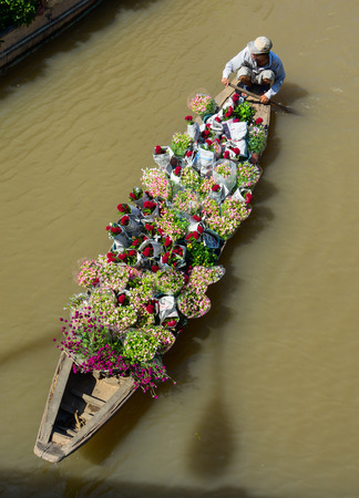 Can Tho, Vietnam - Jan 31, 2016. Wooden boats carrying flowers at spring time in Can Tho, Vietnam. Sajtókép