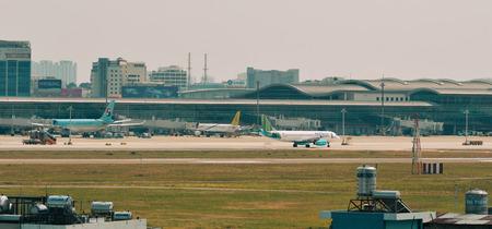 Saigon, Vietnam - Feb 25, 2019. Passenger airplanes docking at Tan Son Nhat Airport (SGN) in Saigon, Vietnam. 新聞圖片