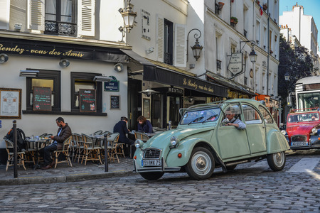Paris, France - Oct 4, 2018. Vintage car on old street in Montmartre district in Paris, France. Montmartre is a large hill in Paris 18th arrondissement. Redakční