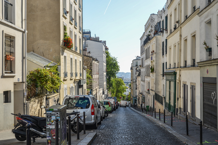 Paris, France - Oct 4, 2018. Beautiful old street in Montmartre district in Paris, France. Montmartre is a large hill in Paris 18th arrondissement.