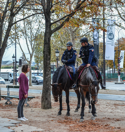 Paris, France - Oct 2, 2018. Gendarmes on horseback in Paris, France. The National Gendarmerie is one of two national police forces of France. Éditoriale