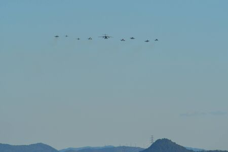 Military aircrafts (fighter jet) flying for display in sunny day.