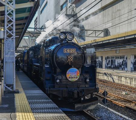 Gunma, Japan - Nov 9, 2019. The C61 steam locomotive (Joyful Train) running on the track in Gunma, Japan. The train was constructed with a boiler after World War II. Editorial
