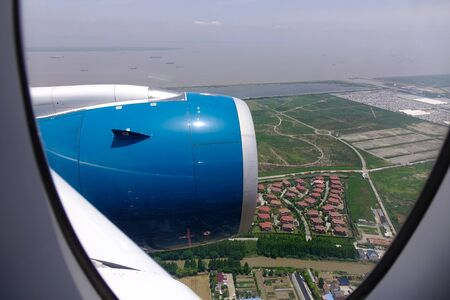 Blue engine of passenger airplane in the sky with cloudscape background.